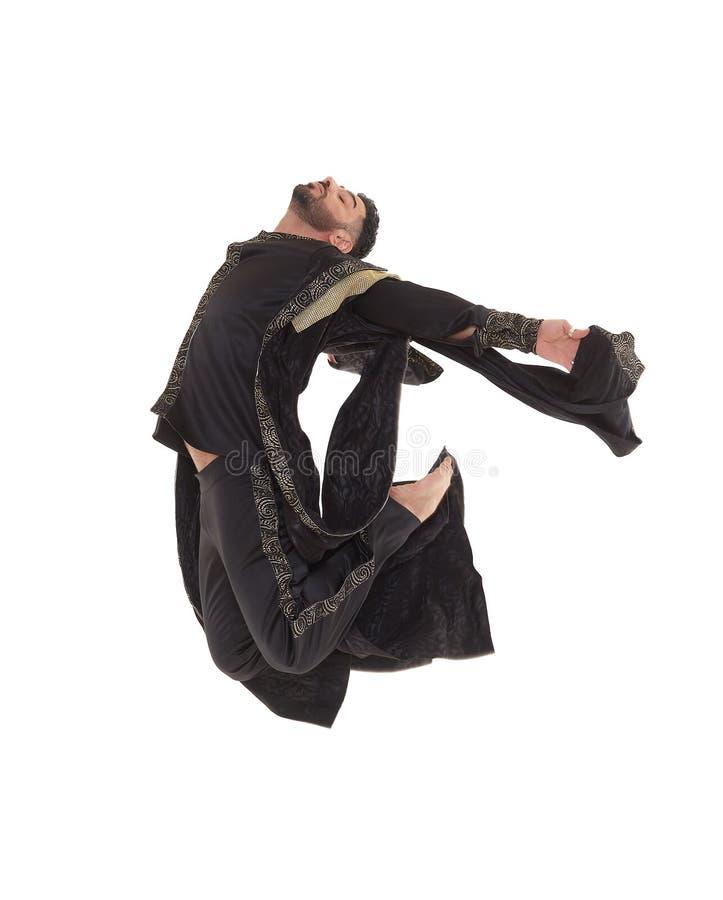 Bailarín de sexo masculino en traje oriental fotografía de archivo libre de regalías