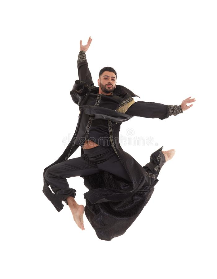 Bailarín de sexo masculino en traje oriental fotografía de archivo