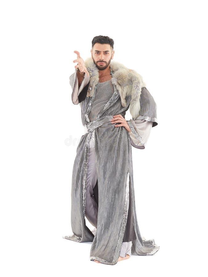 Bailarín de sexo masculino en traje oriental imagen de archivo