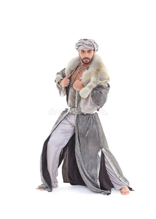 Bailarín de sexo masculino en traje oriental foto de archivo