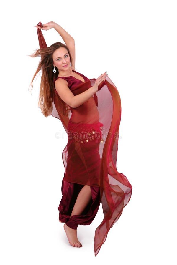 Bailarín de vientre joven hermoso con un velo fotos de archivo