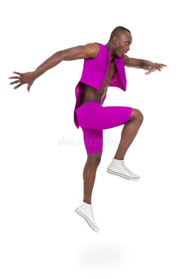 Bailarín del disco que muestra algunos movimientos contra blanco aislado fotografía de archivo libre de regalías