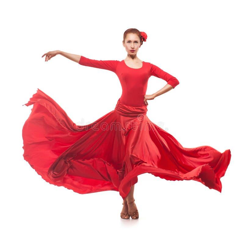 Bailarín de la mujer que lleva el vestido rojo imagen de archivo libre de regalías
