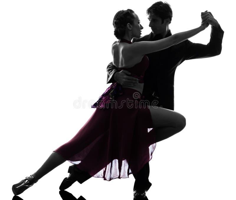 Bailarines del salón de baile de la mujer del hombre de los pares tangoing la silueta imagenes de archivo