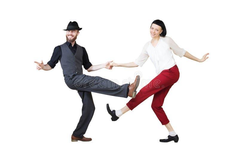 Bailarines del woogie de la boogie de la danza del salto de Lindy o del rollo del ` del ` n de la roca foto de archivo libre de regalías