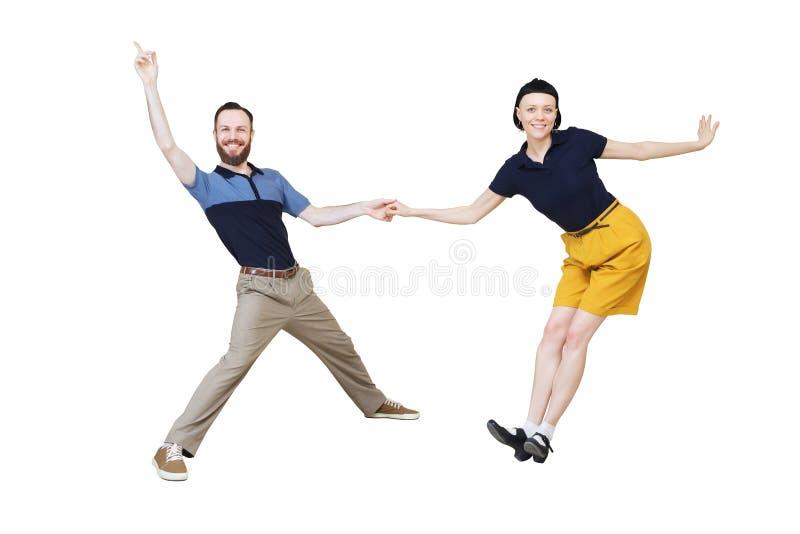 Bailarines del woogie de la boogie de la danza del salto de Lindy o del rollo del ` del ` n de la roca foto de archivo