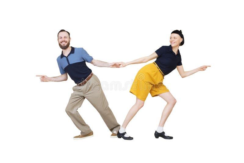 Bailarines del woogie de la boogie de la danza del salto de Lindy o del rollo del ` del ` n de la roca fotos de archivo