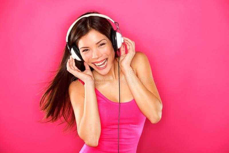Baile de la mujer de la música de los auriculares imágenes de archivo libres de regalías