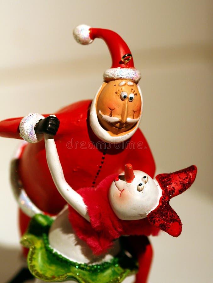 Baile de Santa con snowwoman foto de archivo