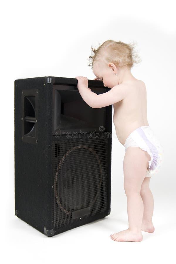 Baile del bebé con el reproductor fotos de archivo libres de regalías