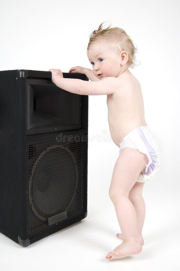 Baile del bebé con el reproductor imagenes de archivo