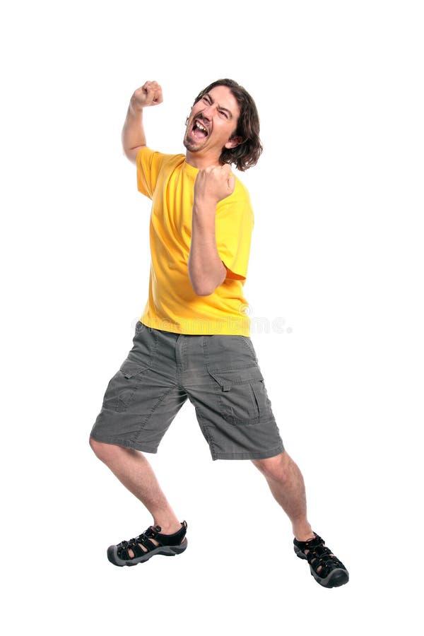 Baile feliz del hombre joven fotografía de archivo