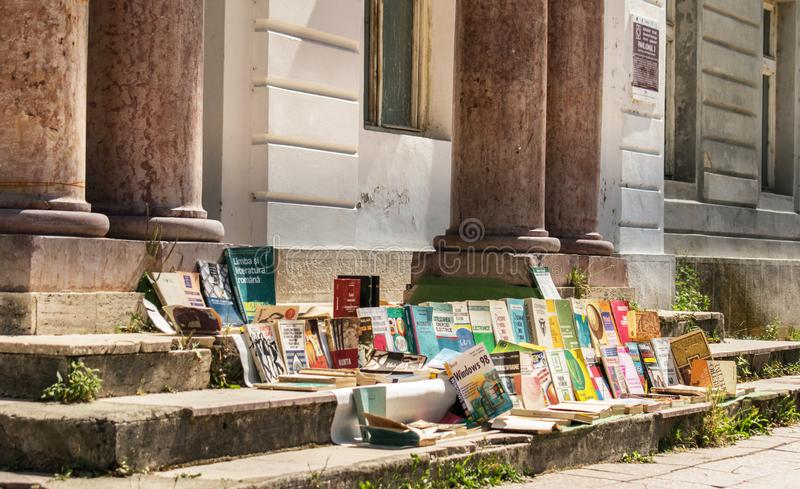 Baile Herculane, Romania. August, 16, 2019- outdoor antique shop. Old books for sale on the stairs of an old house royalty free stock photos