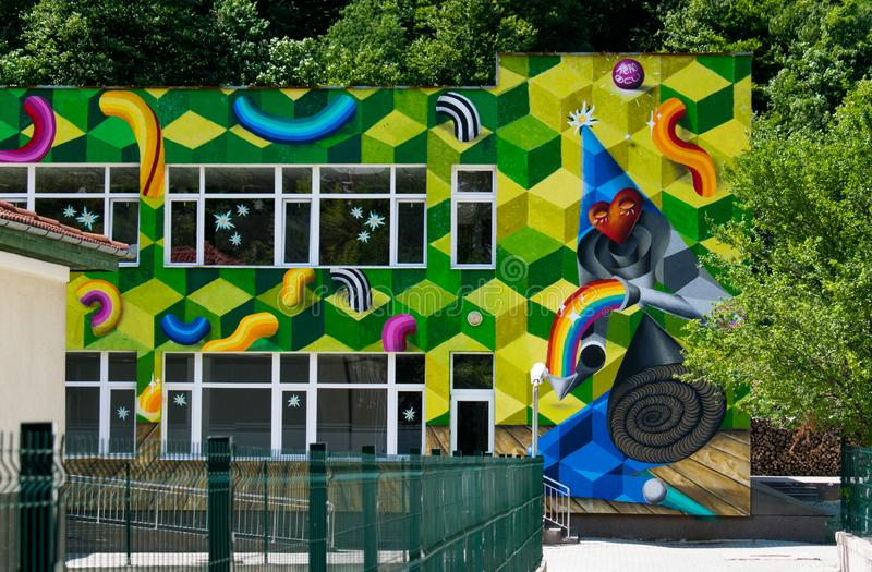 Baile Herculane, Romania. August, 16, 2019- a school painted very beautifully in graffiti, with a three-dimensional model stock photos