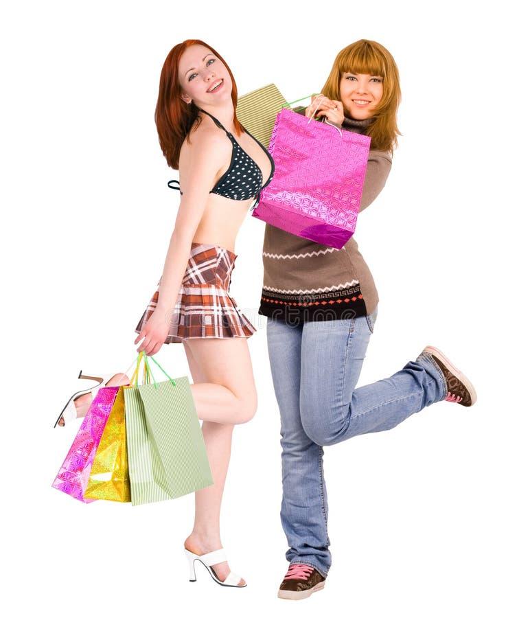 Baile voluptuoso de dos señoras de las compras imagen de archivo