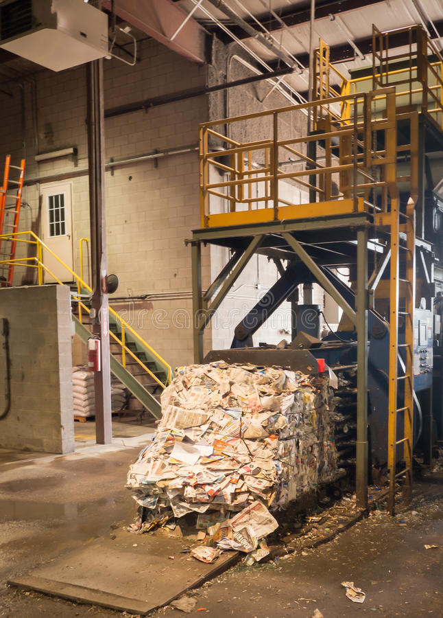 Bailer and Recycle paper. A bailer with a bail of recycled paper stock photo