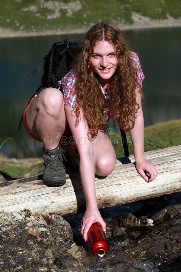 Download Bailing Water From A Brook Stock Photo - Image: 28341570
