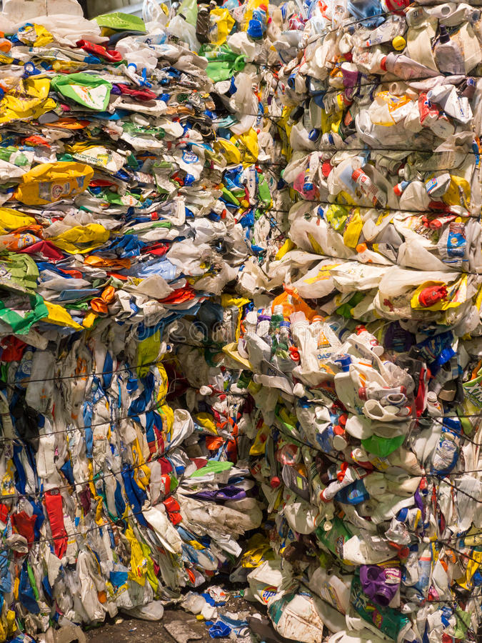Bails of Recycled Plastic. Stacked bails of crushed plastic ready for recycling stock images