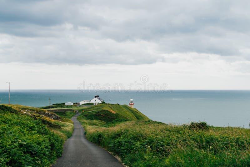 Baily灯塔在一喜怒无常的天, Howth,爱尔兰 免版税库存图片
