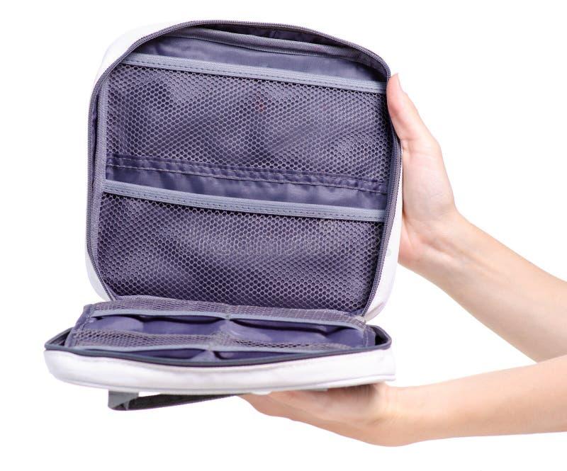 Bain cosmétique de voyage de sac à disposition images stock