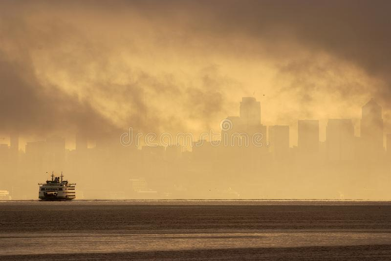 Fog Shrouded Seattle Skyline With a Ferryboat Sailing Into View. royalty free stock images