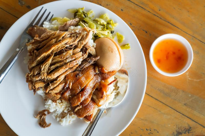 Baised Pork Leg with Steamed Rice on Wood Table.  stock image