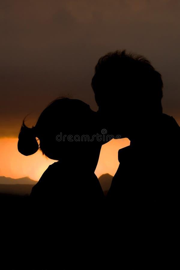 Baiser de coucher du soleil photo libre de droits