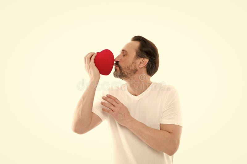 baiser Le coeur a rempli avec amour Rose rouge Soins de sant? Amour Probl?mes avec le coeur Homme avec la barbe D?cor pour image stock
