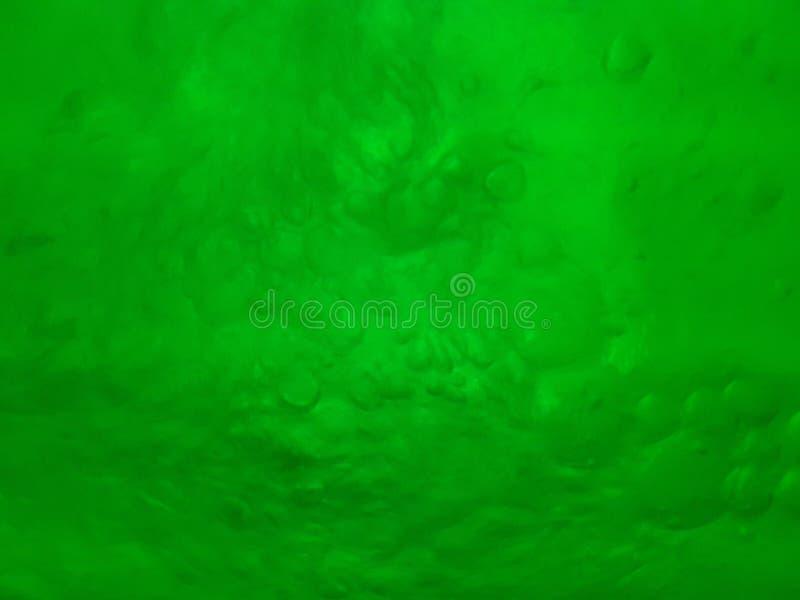 Baisses de bouillonnement de l'eau avec des nuances de vert, texture photo stock