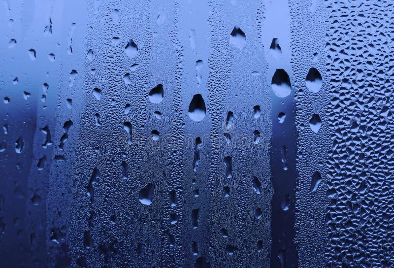 Baisses de l'eau sur la glace images stock