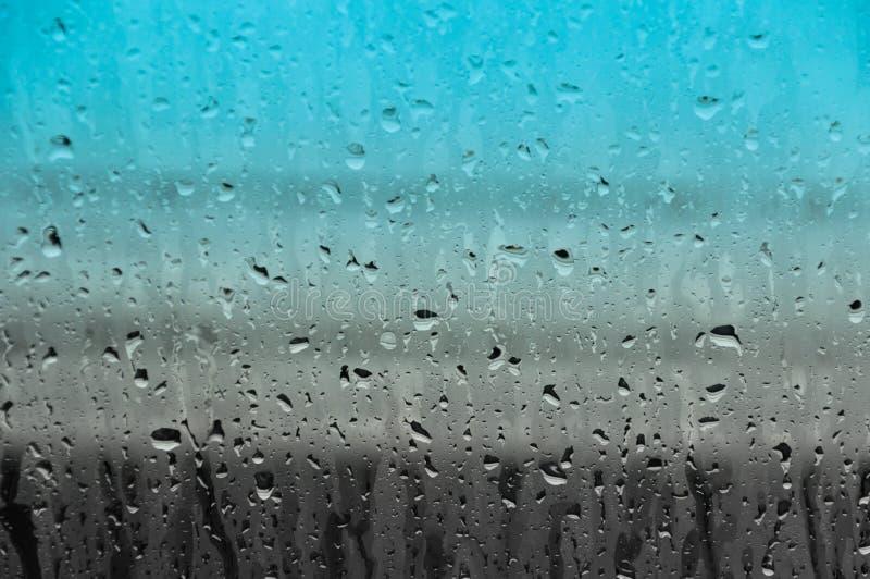 Baisses de l'eau sur le fond en verre d'abrégé sur texture photos stock