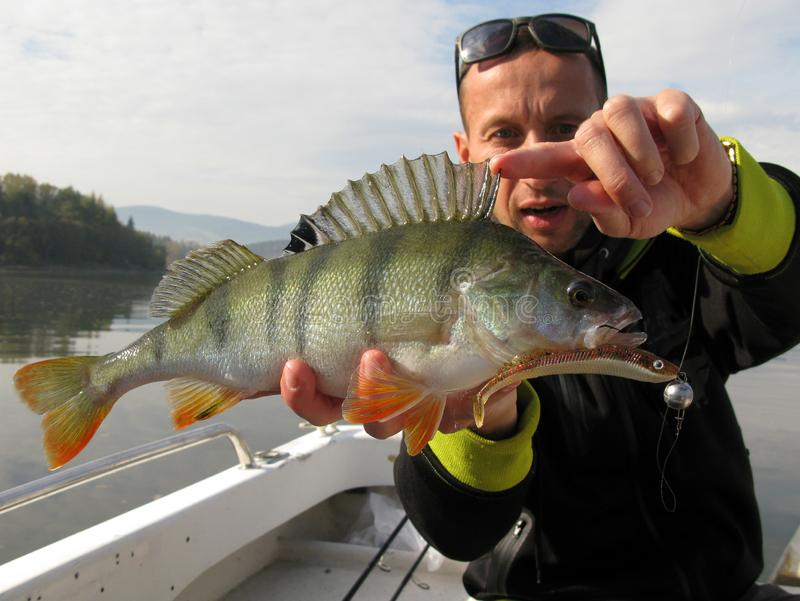 Baitcasting fishing on river with lure royalty free stock photography
