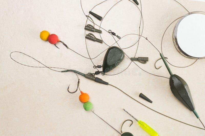 Baits, hooks, sinkers, ledcor is preparing for carp fishing. Copy paste royalty free stock photo