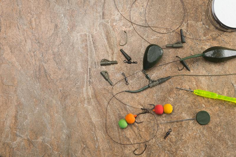 Baits, hooks, sinkers, ledcor is preparing for carp fishing. Copy paste royalty free stock photo