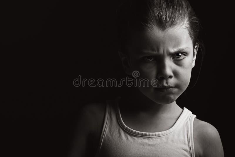 Baixo tiro chave de uma criança com atitude fotos de stock