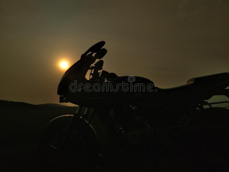 Bajaj Pulsar 220 in Sunset Background. Pulsar 220 in sunset background. Natural pic. no edits royalty free stock image
