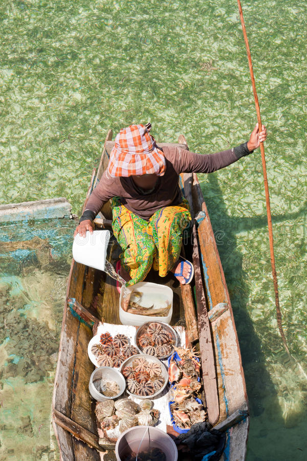 Bajau woman without a face - Mabul island, Borneo, Sabah, Malays stock photography