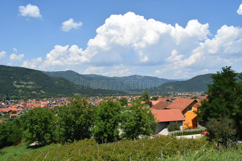 Bajina Basta town, with beautiful clouds. Town near Drina river, west Serbia royalty free stock photography