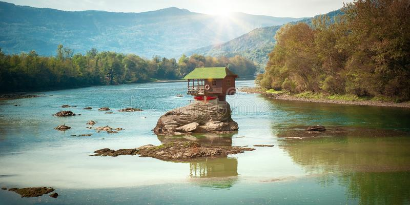 Lonely house on the river Drina in Bajina Basta, Serbia. BAJNA BASTA, SERBIA - 20. OCTOBER 2018. Beautiful lonely house on the river Drina. Day editorial shot stock image