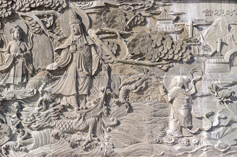 Bajorrelieve chino, piedra, gris imágenes de archivo libres de regalías