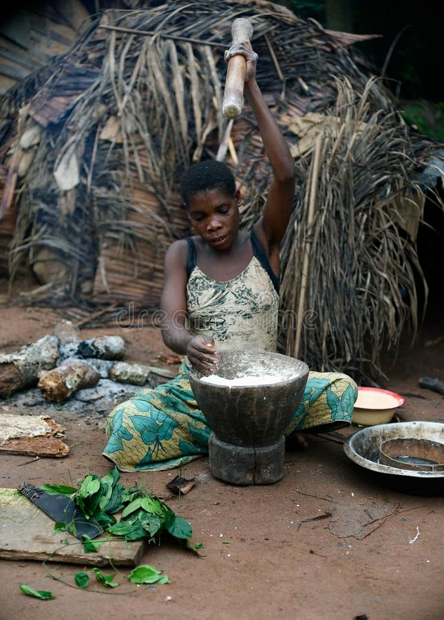 Download The Baka  Woman Pounds A Flour In A Mortar. Editorial Photography - Image: 16659812