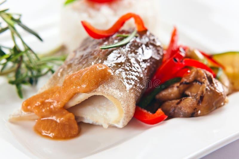 Bakad fisk royaltyfria bilder