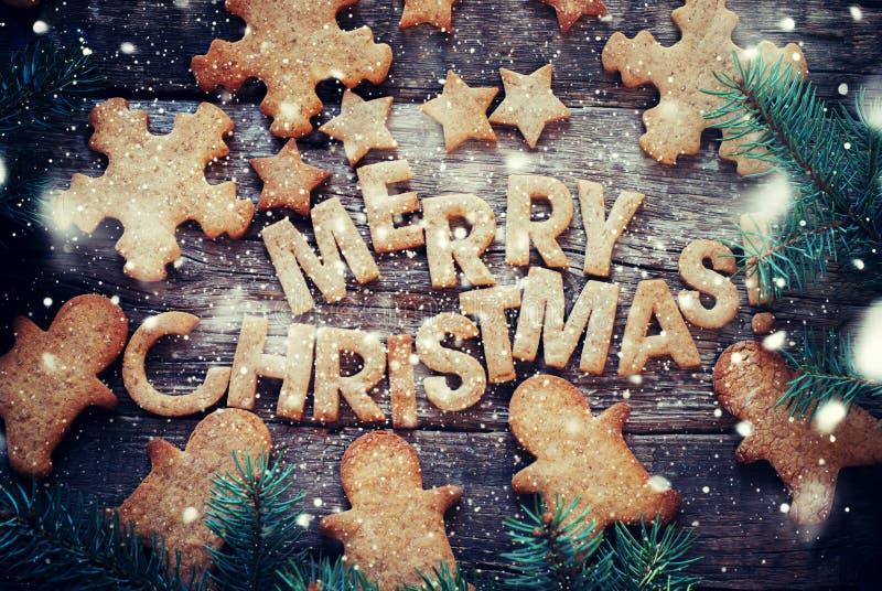 Bakad glad jul för bokstäver Diagram pepparkakakakor royaltyfri bild