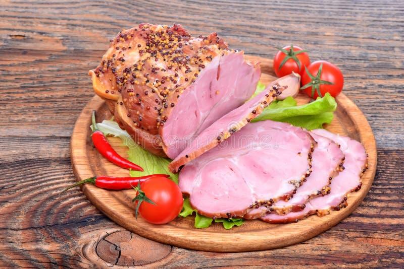 Bakad griskötthals, tomater, peppar royaltyfri fotografi