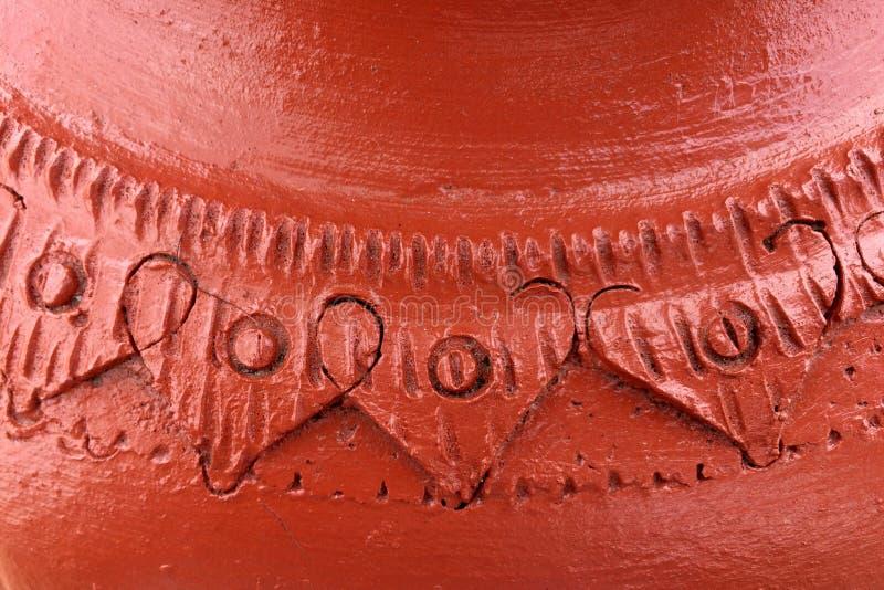 Bakad lera, vägg för bakgrund eller bakad textur av gyttja arkivfoto