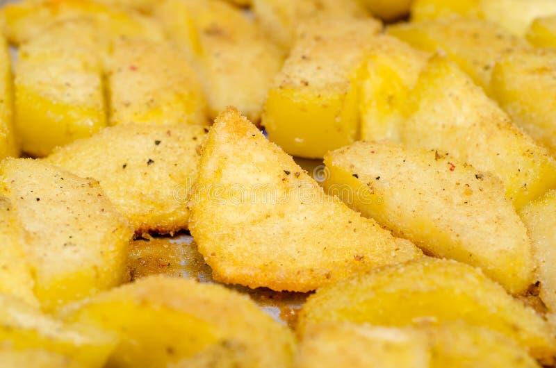 Bakade potatisar royaltyfria bilder