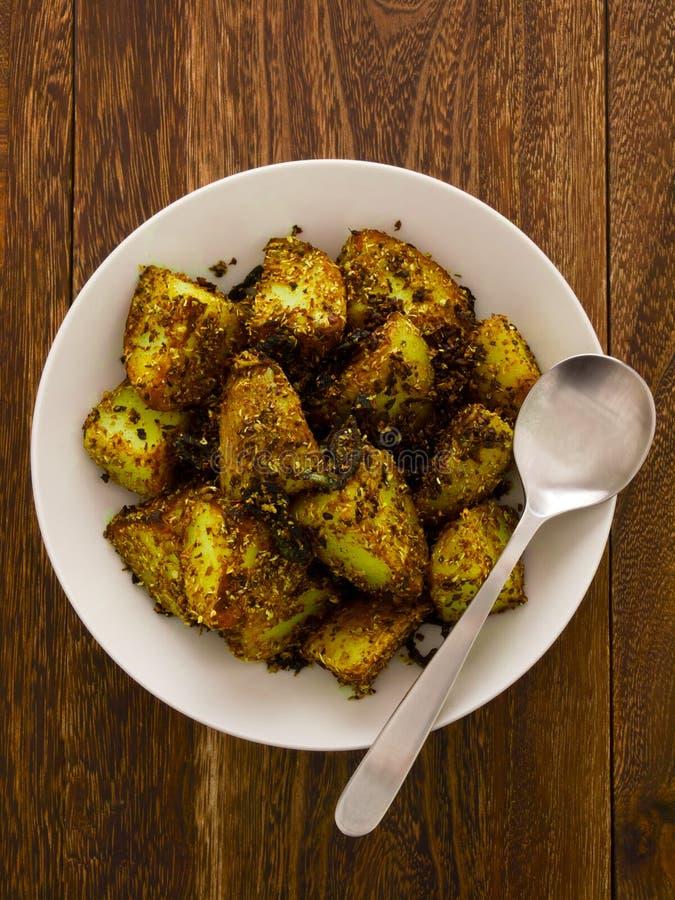 bakade vresiga potatisar fotografering för bildbyråer