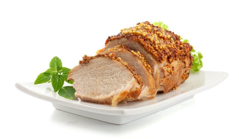Bakat griskött med fransk senap royaltyfri bild