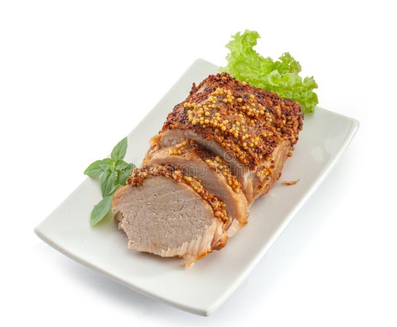 Bakat griskött med fransk senap royaltyfria foton