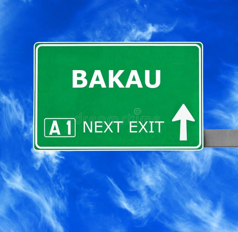 BAKAU road sign against clear blue sky stock photography